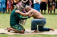 Peia Patei, navigator, Cook Islands, is honored by Kealoha Hoe, Hawaiian voyager, after having received Pwo from Hector Busby, master navigator and canoe builder, Aotearoa... Arrival of Pacific voyaging canoes, Kualoa Regional Park, Hakipu'u, O'ahu, on June 25, 2011.