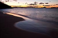 Salomon Beach, at Sunset showing the lights of St Thomas.Virgin Islands National Park.St John, US Virgin Islands