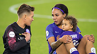 Orlando, FL - Saturday March 24, 2018: Orlando Pride goalkeeper Ashlyn Harris (24) speaks with Orlando Pride forward Sydney Leroux (2) and her child after a regular season National Women's Soccer League (NWSL) match between the Orlando Pride and the Utah Royals FC at Orlando City Stadium. The game ended in a 1-1 draw.