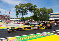 Jun. 1, 2014; Englishtown, NJ, USA; NHRA top fuel driver Tony Schumacher (near lane) races alongside Doug Kalitta  during the Summernationals at Raceway Park. Mandatory Credit: Mark J. Rebilas-