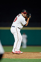 Rochester Red Wings relief pitcher Gabriel Moya (19) gets ready to deliver a pitch during a game against the Pawtucket Red Sox on May 19, 2018 at Frontier Field in Rochester, New York.  Rochester defeated Pawtucket 2-1.  (Mike Janes/Four Seam Images)
