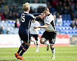 Ross County v St Johnstone…..30.04.16  Global Energy Stadium, Dingwall<br />Graham Cummins battles with Andrew Davies<br />Picture by Graeme Hart.<br />Copyright Perthshire Picture Agency<br />Tel: 01738 623350  Mobile: 07990 594431