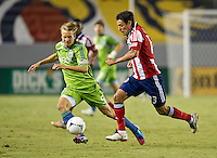 CARSON, CA - August 25, 2012: Seattle defender Adam Johansson (5) and Chivas USA Ante Jazic (13) during the Chivas USA vs Seattle Sounders match at the Home Depot Center in Carson, California. Final score, Chivas USA 2, Seattle Sounders 6.