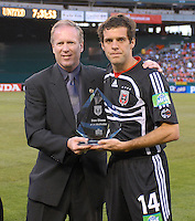 2006 MLS Regular Season Match at RFK Stadium, DC United midfielder Ben Olsen being presented by Kevin Payne with a plaque for the DC United Decade's Best 11, final score DC United 1, FC Dallas 1, Saturday April 29.