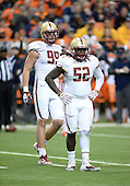 Boston College Eagles linebacker Steven Daniels (52) and lineman Brian Mihalik (99) during a game against the Syracuse Orange at the Carrier Dome on November 30, 2013 in Syracuse, New York.  Syracuse defeated Boston College 34-31.  (Copyright Mike Janes Photography)