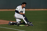 Catcher Scott Manea (25) of the Columbia Fireflies straps on his gear before a game against the Charleston RiverDogs on Tuesday, August 28, 2018, at Spirit Communications Park in Columbia, South Carolina. Columbia won, 11-2. (Tom Priddy/Four Seam Images)