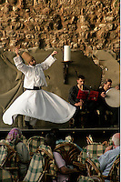 Whirling dervish at a cafe in Istanbul, Turkey