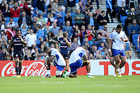 Samoan players pray at the end of the match during Match 6 of the Rugby World Cup 2015 between Samoa and USA - 20/09/2015 - Brighton Community Stadium, Brighton <br /> Mandatory Credit: Rob Munro/Stewart Communications