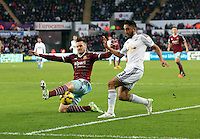 Pictured: Neil Taylor of Swansea is tackled by Carl Jenkinson of West Ham Saturday 10 January 2015<br /> Re: Barclays Premier League, Swansea City FC v West Ham United at the Liberty Stadium, south Wales, UK