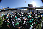 DENTON, TX  JANUARY 1:  North Texas Mean Green huddles before the start of the game against the UNLV Rebels during the Heart of Dallas Bowl at Cotton Bowl Stadium in Dallas on January 1, 2014 in Dallas, TX.  Photo by Rick Yeatts North Texas won 36-14 over UNLV.