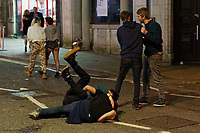 Pictured: Two men play fight in Swansea. Tuesday 31 December 2019 to Wednesday 01 January 2020<br /> Re: Revellers on a night out for New Year's Eve in Wind Street, Swansea, Wales, UK.