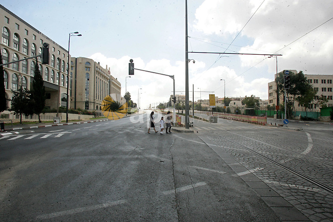 Israeli family walk on an empty street during the Jewish holiday of Yom Kippur in Jerusalem's Old City Sept. 18, 2010. Yom Kippur, or Day of Atonement, which starts at sundown tomorrow, is the holiest of Jewish holidays when observant Jews atone for the sins of the past year . Photo by Mahfouz Abu Turk