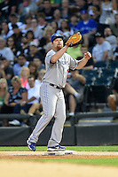 Toronto Blue Jays first baseman Adam Lind (26) waits for a throw during a game against the Chicago White Sox on August 15, 2014 at U.S. Cellular Field in Chicago, Illinois.  Chicago defeated Toronto 11-5.  (Mike Janes/Four Seam Images)