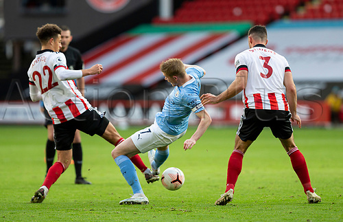 31st October 2020; Bramall Lane, Sheffield, Yorkshire, England; English Premier League Football, Sheffield United versus Manchester City; Ethan Ampadu of Sheffield United tackles Kevin De Bruyne of Manchester City for the ball watched by Enda Stevens of Sheffield United