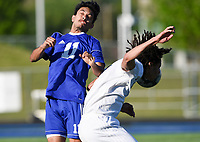 NWA Democrat-Gazette/CHARLIE KAIJO Rogers High School Felipe Rodriguez (11) and Bentonville High School Elliott Nimrod (9) collide as they head the ball during a soccer game, Friday, April 26, 2019 at  Whitey Smith Stadium at Rogers High School in Rogers.