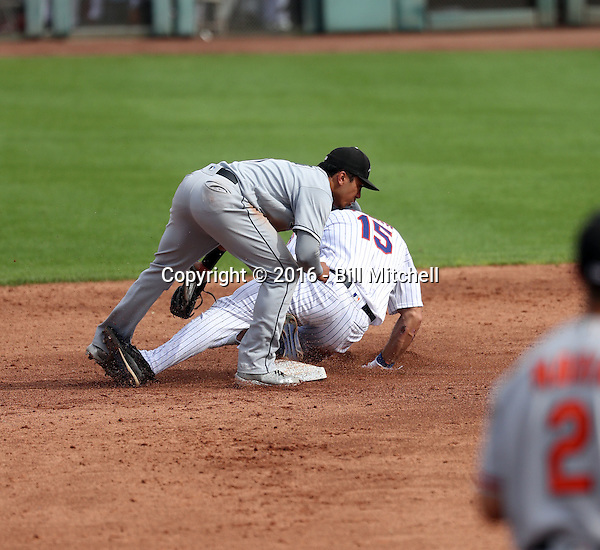 Tim Tebow of the Scottsdale Scorpions apparently injures his knee on a slide into second base in an Arizona Fall League game against the Peoria Javelinas at Scottsdale Stadium on October 31, 2016 in Scottsdale, Arizona. The Peoria second baseman taking the throw is Kean Wong. Tebow left the game after being called out on the attempted steal (Bill Mitchell)