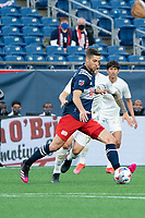 FOXBOROUGH, MA - MAY 1: Matt Polster #8 of New England Revolution kicks the ball downfield during a game between Atlanta United FC and New England Revolution at Gillette Stadium on May 1, 2021 in Foxborough, Massachusetts.