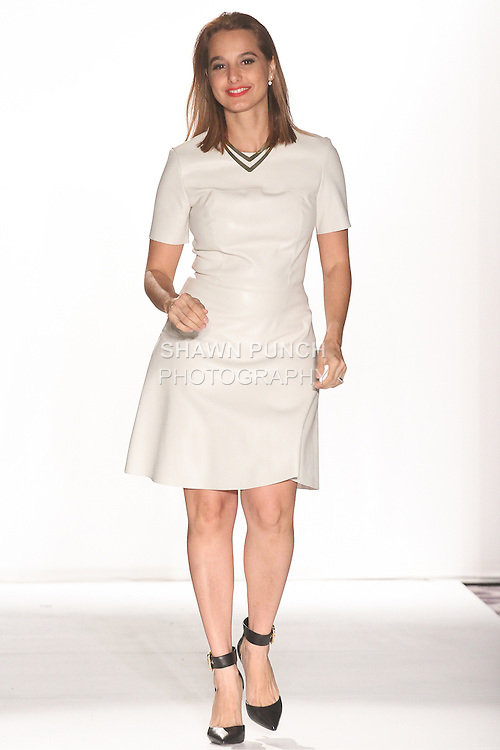 "Fashion designer Michelle Ann thanks audience for attending her Michelle Ann Fall Winter 2015 ""Glimmerati"" collection runway show during the Designer's Collective Fall Winter 2015 fashion show for Fashion Gallery New York Fashion Week Fall 2015."