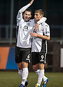 Queen of the South's Kevin Holt (9) is congratulated by Derek Young (6) after he scores their third goal.