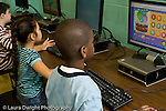 Education Elementary school Grade 2 male and female students using computers in science computer lab horizontal