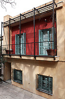 balcony with french doors..Tholou street is a small road below the Acropolis in Athens.Most Athenians know about that region because of the Old University. Almost opposite, the architect Stamos Fafalios gave life to an old, neglected house .