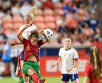 HOUSTON, TX - JUNE 10: Lindsey Horan #9 of the United States heads the ball over Andreia Norton #8 of Portugal during a game between Portugal and USWNT at BBVA Stadium on June 10, 2021 in Houston, Texas.