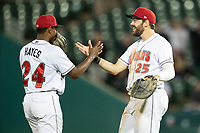 Ke'Bryan Hayes (24) and Will Craig (25) of the Indianapolis Indians celebrate after the game at Victory Field on May 14, 2019 in Indianapolis, Indiana. The Indians defeated the RailRiders 4-2. (Andrew Woolley/Four Seam Images)