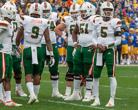 Miami Hurricanes quarterback N'Kosi Perry (5) leads the Miami offense in a huddle. The Miami Hurricanes football team defeated the Pitt Panthers 16-12 in a game at Heinz Field, Pittsburgh, Pennsylvania on October 26, 2019.
