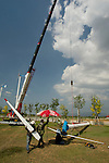 Maintenance on the King's Wind Farm in Thailand. A wind farm constructed of 20 small 10 KW wind turbines specifically built for low wind speeds in Thailand.