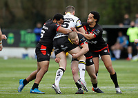 28th March 2021; Rosslyn Park, London, England; Betfred Challenge Cup, Rugby League, London Broncos versus York City Knights; Romain Navarrete of London Broncos is tackled by Daniel Hindmarsh, Sam Davis and Josh Walters of London Broncos