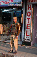 A grim faced soldier stands guardoutside a hotel in central Srinagar, Kashmir, India. © Fredrik Naumann/Felix Features