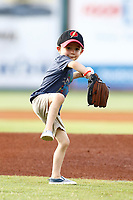 A local youth throws out a ceremonial first pitch prior to the start of the Southern League game between the Montgomery Biscuits and the Chattanooga Lookouts on May 26, 2018 at AT&T Field in Chattanooga, Tennessee. (Andy Mitchell/Four Seam Images)