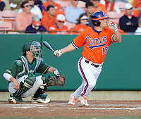 Outfielder Tyler Slaton (18) of the Clemson Tigers in a game against the University of Alabama-Birmingham on Feb. 17, 2012, at Doug Kingsmore Stadium in Clemson, South Carolina. UAB won 2-1. (Tom Priddy/Four Seam Images)