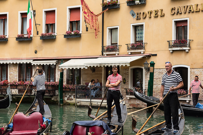 Gondoliers navigate waiting for customers, Venice, Italy