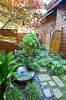 Small space private secluded Japanese style garden room behind walls of California home