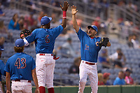 Philadelphia Phillies Matt Joyce (35), on rehab assignment with the Clearwater Threshers, high fives Carlos De La Cruz (6) during a game against the Dunedin Blue Jays on May 18, 2021 at BayCare Ballpark in Clearwater, Florida.  (Mike Janes/Four Seam Images)