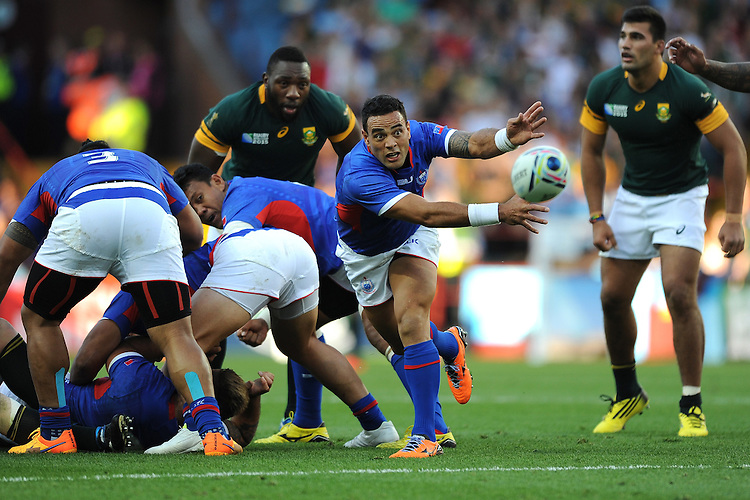 Kahn Fotuali'i of Samoa passes during Match 15 of the Rugby World Cup 2015 between South Africa and Samoa - 26/09/2015 - Villa Park, Birmingham<br /> Mandatory Credit: Rob Munro/Stewart Communications
