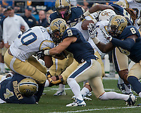 Pitt defensive back Ray Vinopal (9) and linebacker Bam Bradley (4) tackle Georgia Tech running back Synjyn Days (10). The Georgia Tech Yellow Jackets defeated the Pitt Panthers 56-28 at Heinz Field, Pittsburgh Pennsylvania on October 25, 2014.