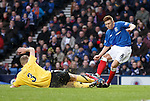 Lewis MacLeod jars his knee in a tackle with Montrose defender Paul Watson and is stretchered off