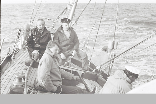 Sheets slightly eased, good progress southwards down the Irish Sea, Dick Brown on helm with Jim McCready and Michael McKee, Francis Drake (back of head) on right, all a bit thoughtful as we've to get round Land's End before a sou'west gale arrives. Photo: W M Nixon