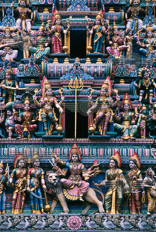 Statues of Hindu goddesses in a temple in Little India.