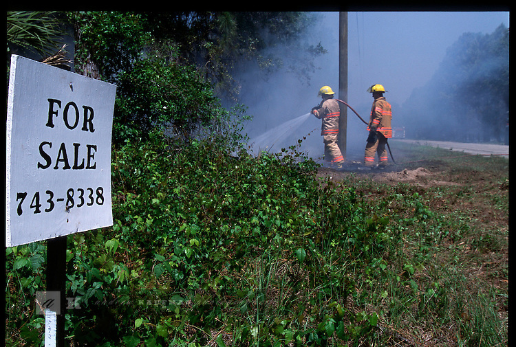 4-21-01.Local real-estate is for sale in North Port, Florida. Wildfires have been caused by the drought and the suburban sprawl where residents are now living in areas once reserved for wildlife.