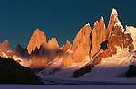 Passing clouds create a dance of light on the granite facade on Cerro Torre and Fitz Roy of the southern Andes