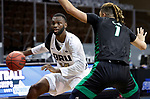 SIOUX FALLS, SD - MARCH 7: DeShang Weaver #14 of the Oral Roberts Golden Eagles looks to make a move against Seybian Sims #1 of the North Dakota Fighting Hawks during the Summit League Basketball Tournament at the Sanford Pentagon in Sioux Falls, SD. (Photo by Richard Carlson/Inertia)