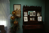 "Family herlooms include an organ topped with family pictures in the living room. <br /> It took several years and a lot of money and determination, but kin of the Caudill family fought to keep their family homestead on Mud River from being taken over by St. Louis-based Arch Coal Company. Nearly swindled out of their homestead, they battled all the way to the West Virginia Supreme Court where they finally won their case.<br /> <br /> For 100 years, Miller's wife and family owned the 75-acre tract that includes a farmhouse, built in 1920, several small barns and a garden. <br /> <br /> John Caudill, a coal miner who was blinded in a mining accident in the 1930s, and his wife, Lydia Caudill, raised 10 children in the home. Today, the family no longer lives there. The heirs spend almost every weekend there. <br /> <br /> Arch Coal wanted to tear down the family's ancestral home. It stands in the way of the company's plans to continue to expand its Hobet 21 mountaintop removal complex. Last year, <br /> Hobet 21 produced about 5.2 million tons of coal, making it among the largest surface mines in the state. Under Hobet's <br /> plans, ""a valley fill and in impoundment pond would destroy <br /> and inundate the farmhouse and outbuildings and bury the immediate surrounding land under the valley fill.""  A lower court agreed with the company, but in the end, the family won."