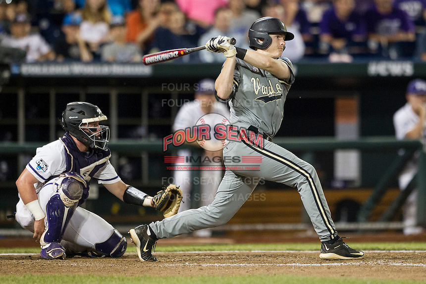 Vanderbilt Commodores third baseman Will Toffey (10) follows through on his swing during the NCAA College baseball World Series against the TCU Horned Frogs on June 16, 2015 at TD Ameritrade Park in Omaha, Nebraska. Vanderbilt defeated TCU 1-0. (Andrew Woolley/Four Seam Images)