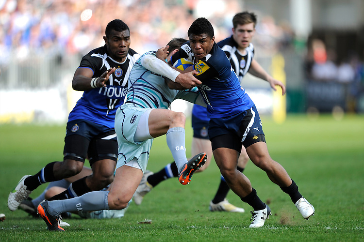 Kyle Eastmond of Bath Rugby brushes aside Toby Flood of Leicester Tigers during the Aviva Premiership match between Bath Rugby and Leicester Tigers at The Recreation Ground on Saturday 20th April 2013 (Photo by Rob Munro)