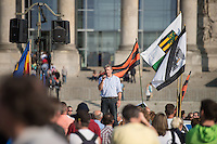 """200 bis 300 Reichsbuerger, Neonazis, Antisemiten und Verschwoerungstheoretiker versammelten sich am 3. Oktober 2014 zu einem """"Sturm auf den Reichstag"""". Die sogenannten Reichsbuerger erkennen die hiesigen Gesetze und Institutionen nicht an. Deutschland sei 1945 nicht befreit sondern besetzt worden und Grenzen des Deutschen Reiches von 1937 wuerden immer noch gelten. Anhaenger dieser Gruppierung fallen immer wieder durch Holocaustleugnung und Volksverhetzung auf.<br /> Zu den Kundgebungsteilnehmern sprach neben bekennenden Rechten auch der deutsche Pop- und Schlagersaenger Xavier Naidoo.<br /> 3.10.2014, Berlin<br /> Copyright: Christian-Ditsch.de<br /> [Inhaltsveraendernde Manipulation des Fotos nur nach ausdruecklicher Genehmigung des Fotografen. Vereinbarungen ueber Abtretung von Persoenlichkeitsrechten/Model Release der abgebildeten Person/Personen liegen nicht vor. NO MODEL RELEASE! Don't publish without copyright Christian-Ditsch.de, Veroeffentlichung nur mit Fotografennennung, sowie gegen Honorar, MwSt. und Beleg. Konto: I N G - D i B a, IBAN DE58500105175400192269, BIC INGDDEFFXXX, Kontakt: post@christian-ditsch.de<br /> Urhebervermerk wird gemaess Paragraph 13 UHG verlangt.]"""