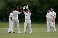 M Irfan of Hornchurch celebrates with his team mates after taking the wicket of L Hawes during Billericay CC (batting) vs Hornchurch CC, Hamro Foundation Essex League Cricket at the Toby Howe Cricket Ground on 12th June 2021