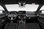Stock photo of straight dashboard view of 2021 BMW 5-Series 530e-Edition-M-Sport 4 Door Sedan Dashboard